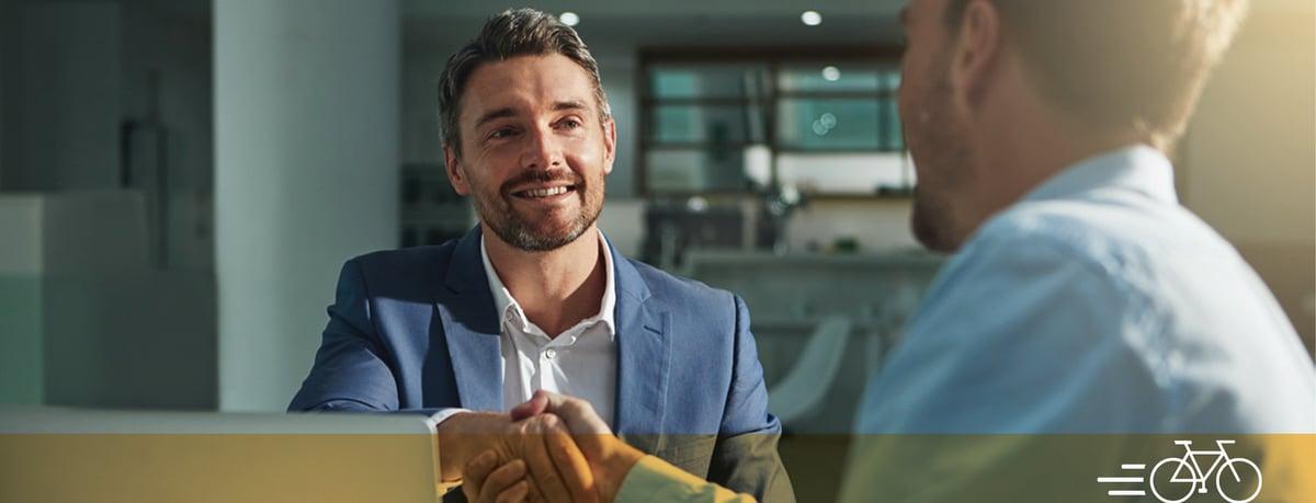 Businessmen-shaking-hands-600x230-saffron