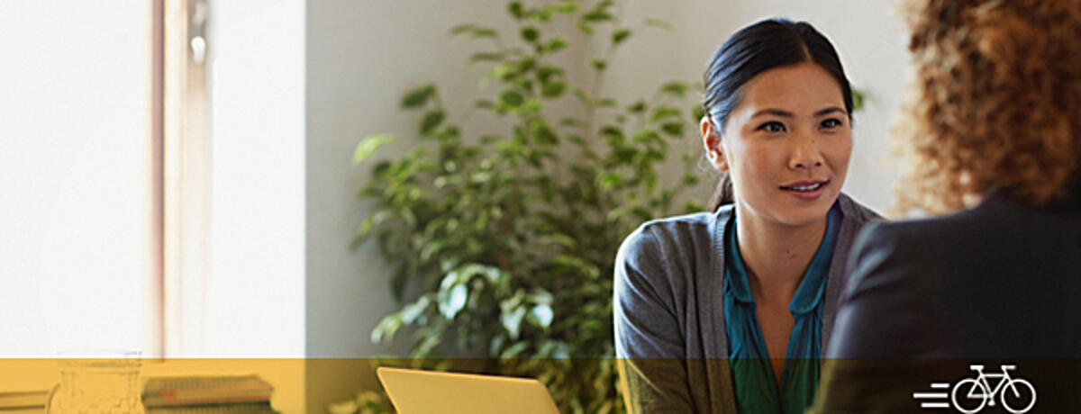 Business-women-discussing-project-Header Image