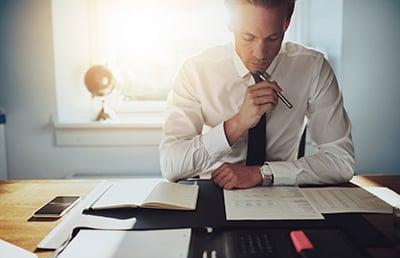 businessman-desk-pen-document-review