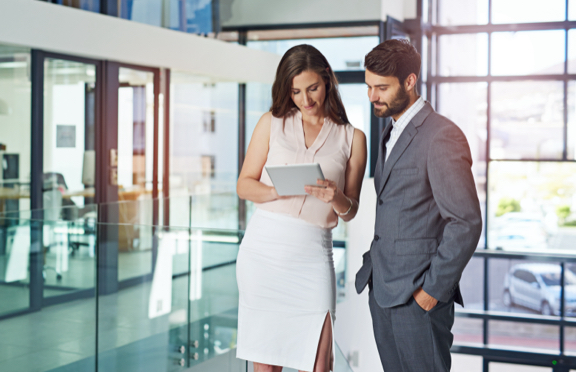 Two-business-people-looking-at-tablet-HS-288x186